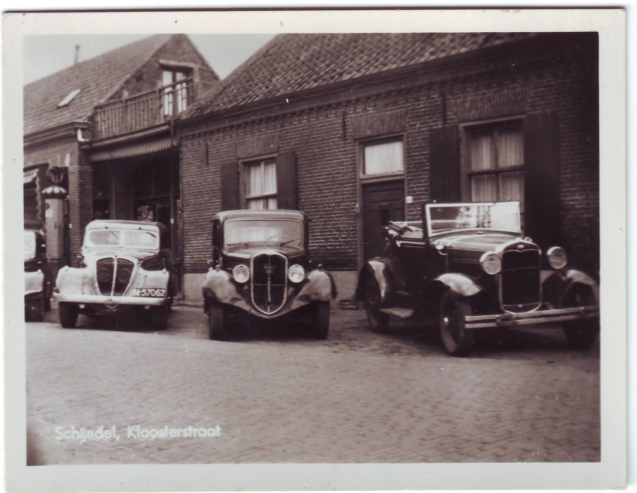 Three cars on a street